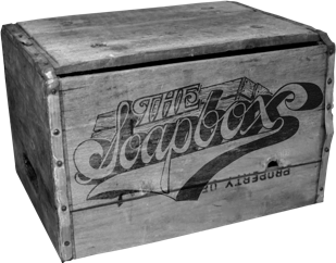 A wooden crate with the words The Soapbox emblazoned on it