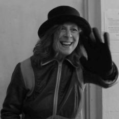 A photo of Rose Jacobson, waving.